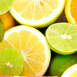 A variety of cut citrus fruits.