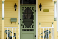 A decorative storm door outside the front of a home.