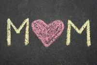 Mom written in chalk with a heart