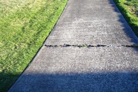 How to repair a cracked sidewalk for Removing concrete walkway