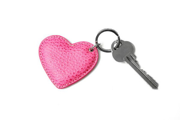 A heart key chain and a key.