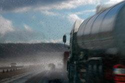 Semi truck driving in rain