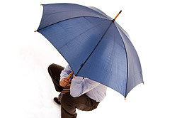 Man holding an umbrella over himself