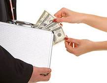 Woman's hands taking money from a briefcase