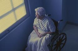 Woman in wheelchair looking outside