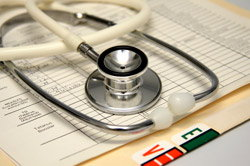 Medical Records and Stethescope