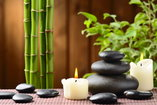 candles, rocks and bamboo spa atmosphere