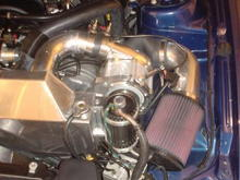 Closeup of water/air intercooler, blower, oil tank