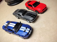 I found the red 1/38 scale '15 Mustang. The other two I have had for a while. All came from Kroger grocery stores.