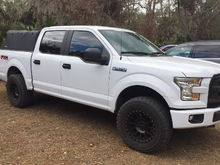 """Pro Comp wheels, 2.5"""" F150 lifts level, 34"""" Cooper Discover ST Max, Soft topper."""