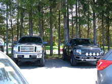 My truck sitting beside a Raptor