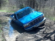 slipped into some mud on the way back from the fishing hole... inspired my new leveling kit and A/T tires