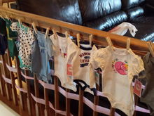 My mom bought onesies and my sister made this clothes line. So cute!