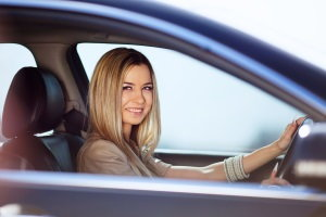 smiling woman in car, buy a car