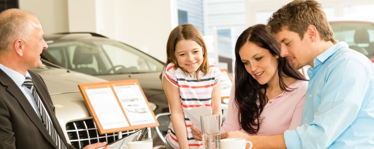 family buying a car at dealership