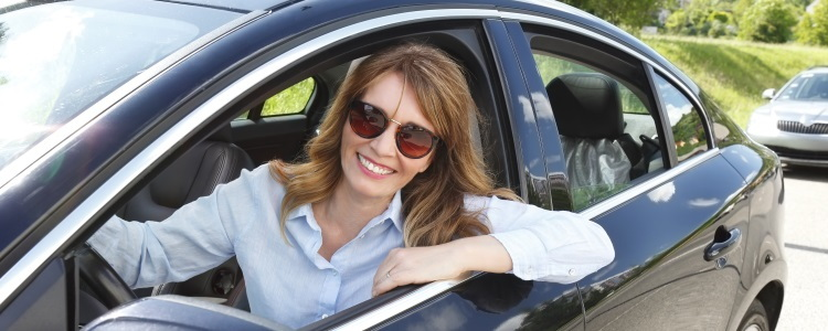 woman happy in her new car