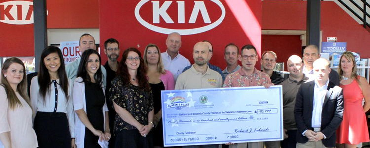 Auto Credit Express & Summit Place Kia Donate to Veterans Treatment Court