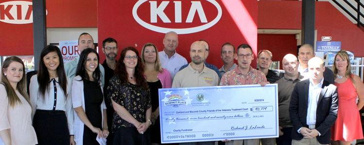 Auto Credit Express & Summit Place Kia Donate to Veterans Treatment Court