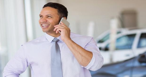 car salesman on the phone