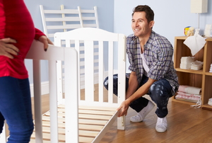couple putting together a crib