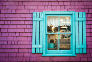 teal window frame and board and batten shutters