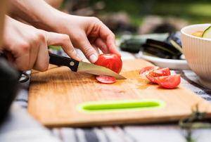 A knife cutting tomatoes.