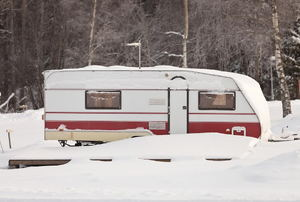 An RV with snow around it.