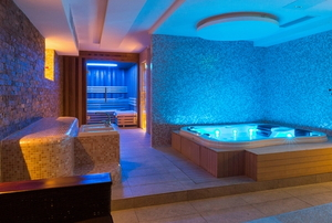 indoor spa and hot tub with colorful lighting
