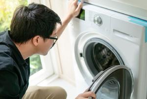 Person looking inside an open dryer