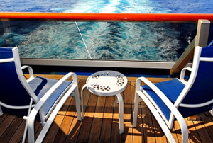 Two chairs on the back of a moving boat