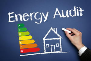 """A chalkboard with the words """"energy audit"""" on it and a house with energy levels next to it."""