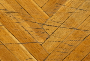 a hardwood floor with scratches