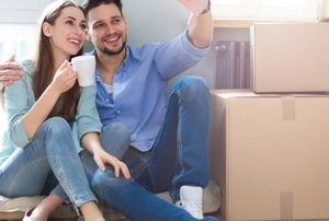 a couple with moving boxes