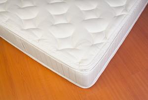 mattress on a floor