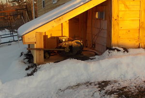 Shed surrounded by snow