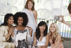 women pose for a picture at a bridal shower