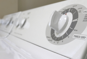 Top of a white clothes dryer showing the timer knob