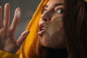 woman stuck to window glass
