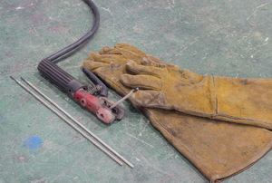 Welding supplies including gloves and electrodes.