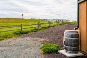 rain barrel next to barn with gutter