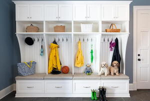 A mudroom with a white storage cabinet and bench.