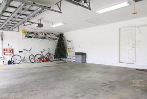 large garage with shelving and bikes in one corner