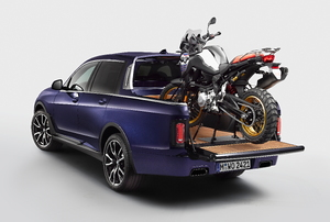 a blue truck with a motorcycle mounted in the bed