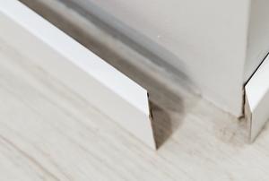 loose base board on wall and floor corner