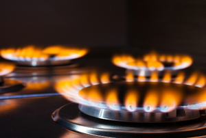 Flames shooting from stovetop burners