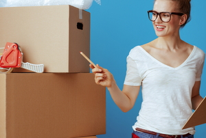 woman with boxes and clipboard preparing for a move