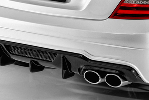 The exhaust pipe on a white vehicle.