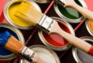 Variety of open paint cans and brushes