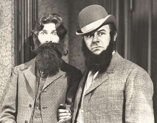 Old black and white image of men with beards.