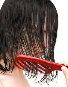 Image of a comb brushing through wet hair.